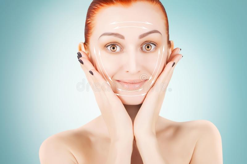 Red haired woman with surgery marks, blue background stock image