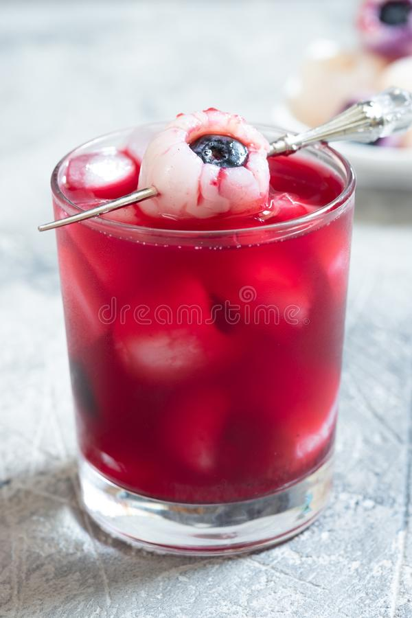 Halloween cocktail with lychee and blueberry eye royalty free stock photo