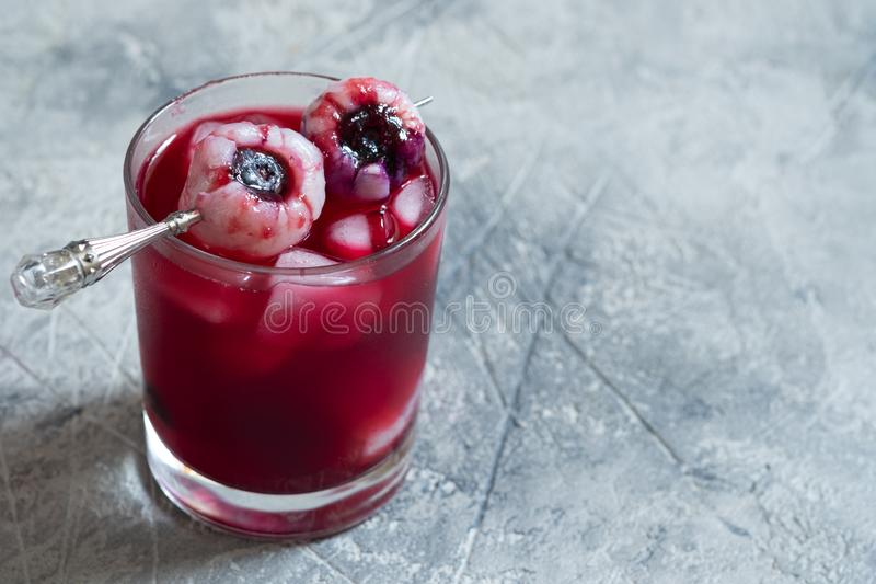 Red halloween cocktail with eye stock photo