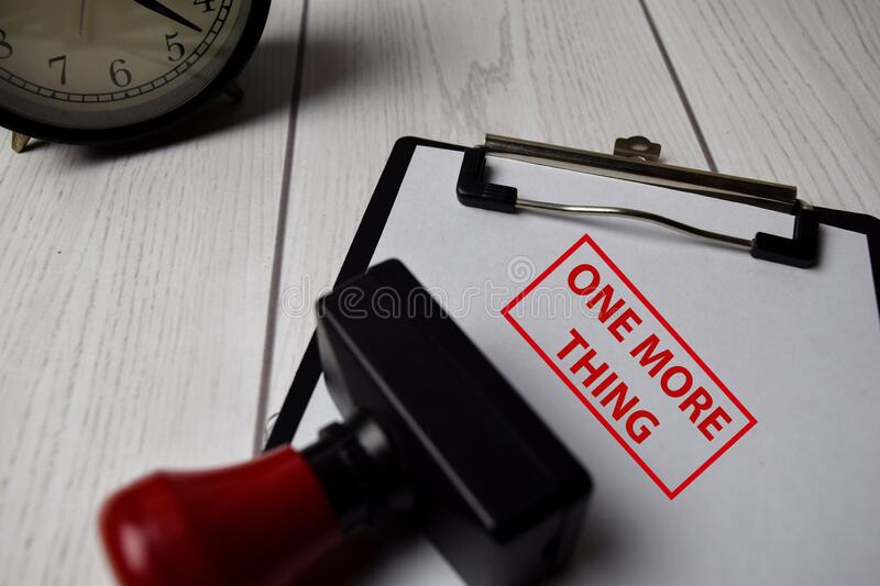 Red Handle Rubber Stamper and One More Thing text isolated on White Background royalty free stock image