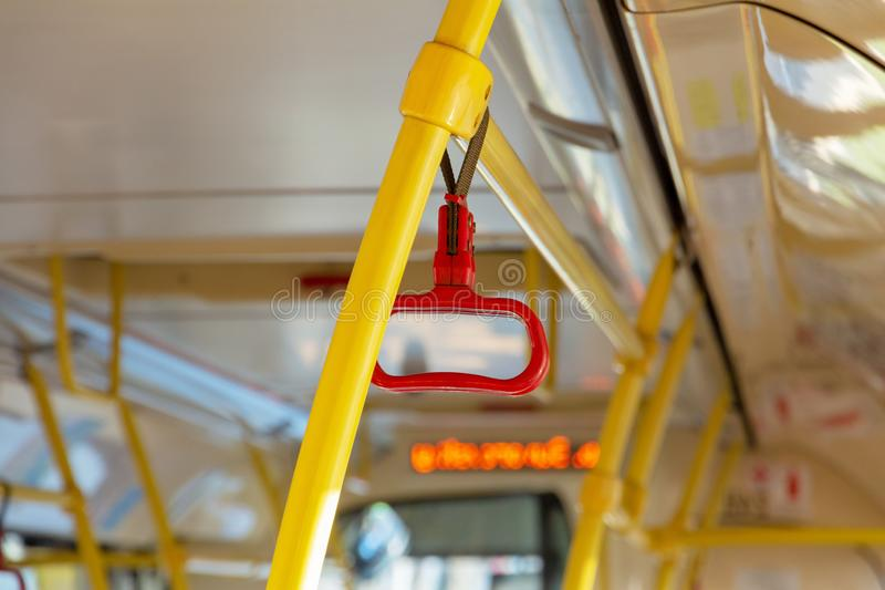 Red handrails in an empty bus stock photography