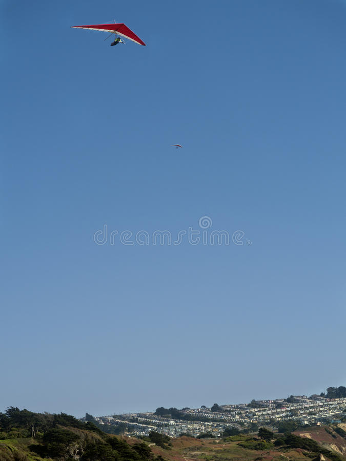 Download Red hang glider above stock image. Image of neighborhood - 26351835