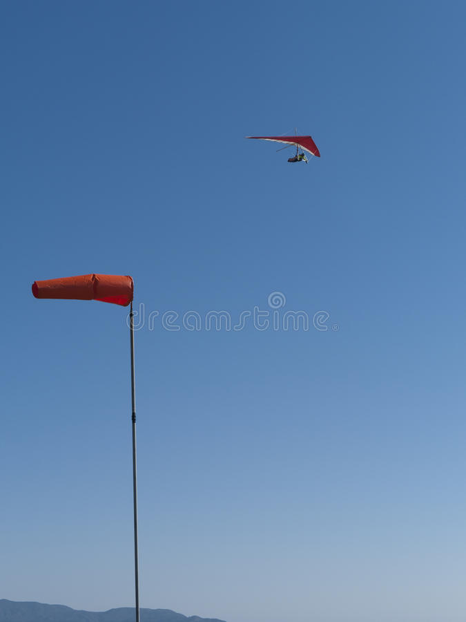 Download Red Hang Glider Above With Wind Cone Stock Photography - Image: 26351832