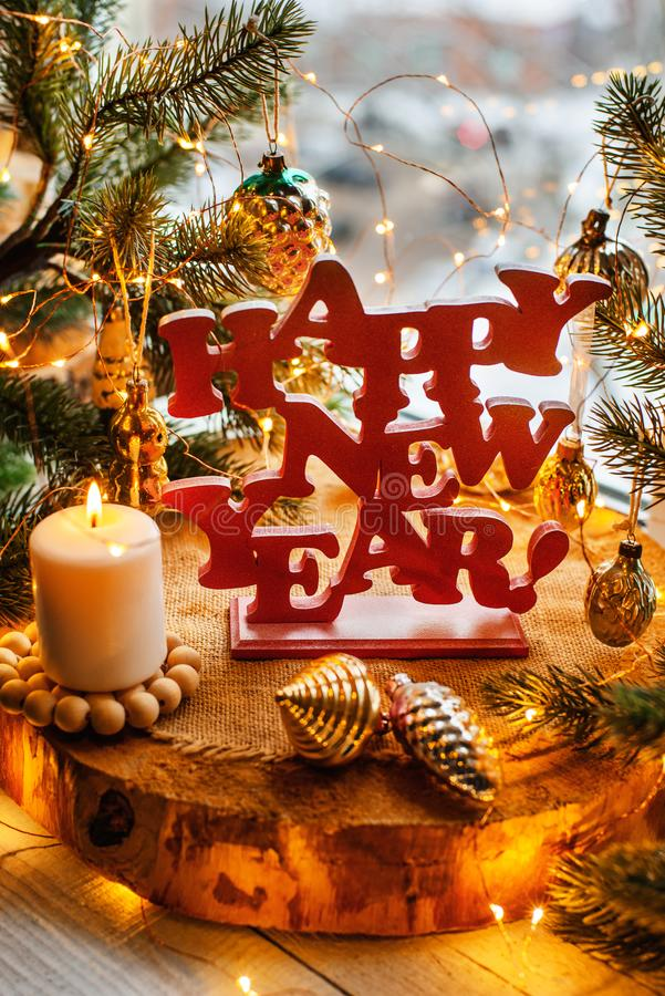 Happy new year. Red happy new year sign on a wooden background with fur tree, lights and vitntage Soviet toys royalty free stock photo