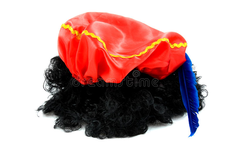 Red hat and black hair of Zwarte Piet stock image