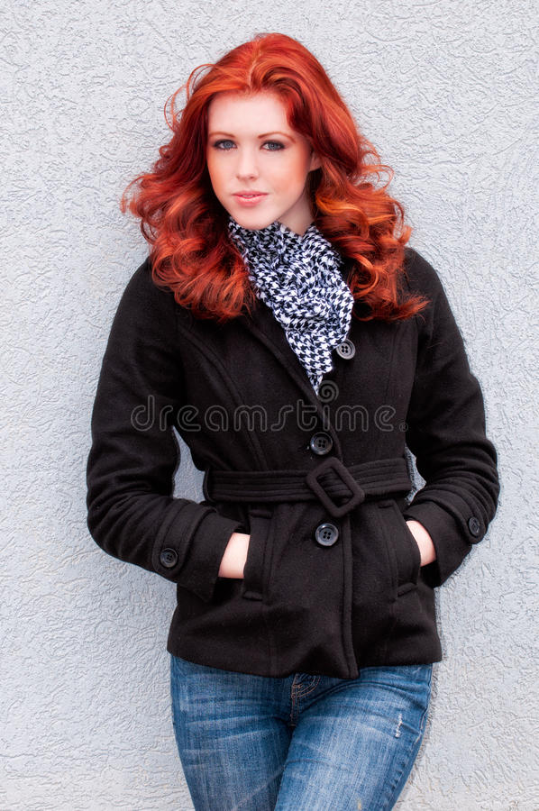Red head in blue jeans stock images
