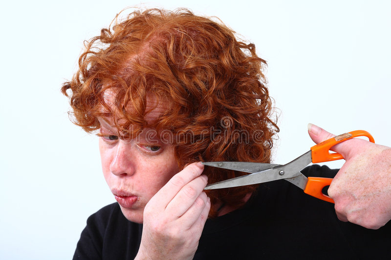 Red head woman cutting hair royalty free stock photos