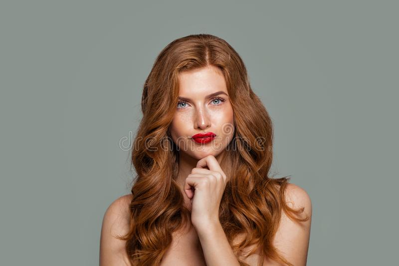Red head woman thinking. Doubt and choice concept. Expressive facial expressions stock image