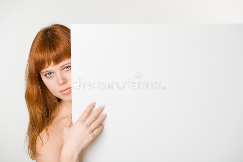 Red headed woman with sign