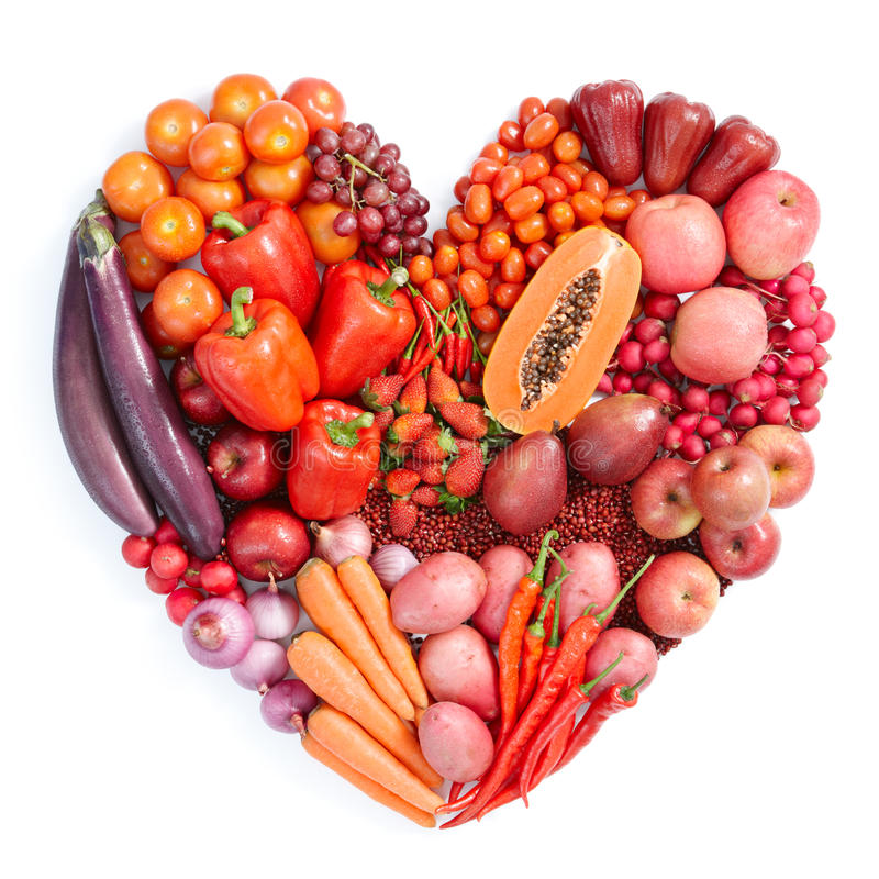 Red healthy food. Heart shape form by various vegetables and fruits