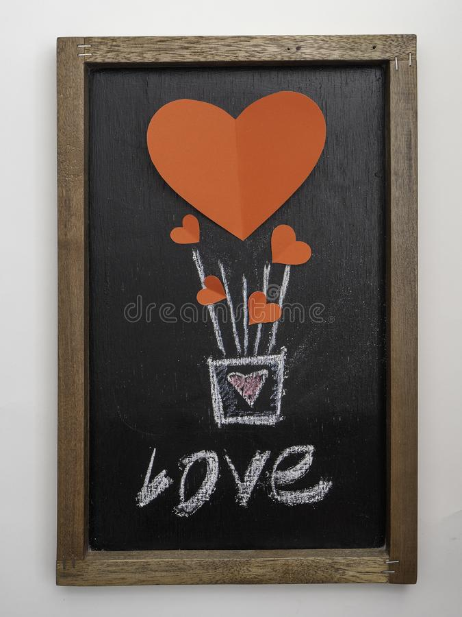 Red heart balloon for Valentines Day blackboard royalty free stock images
