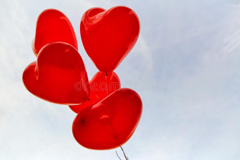 Red heart balloons on a background of sky. royalty free stock photos