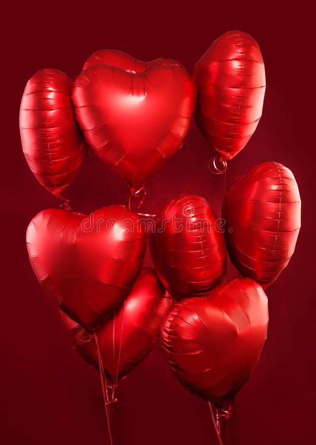 Red heart balloons on red background. Valentine`s day concept.  royalty free stock image