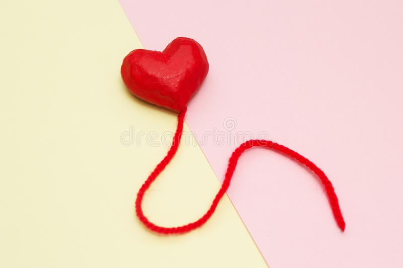 Red heart balloons on a yellow and pink background stock photography