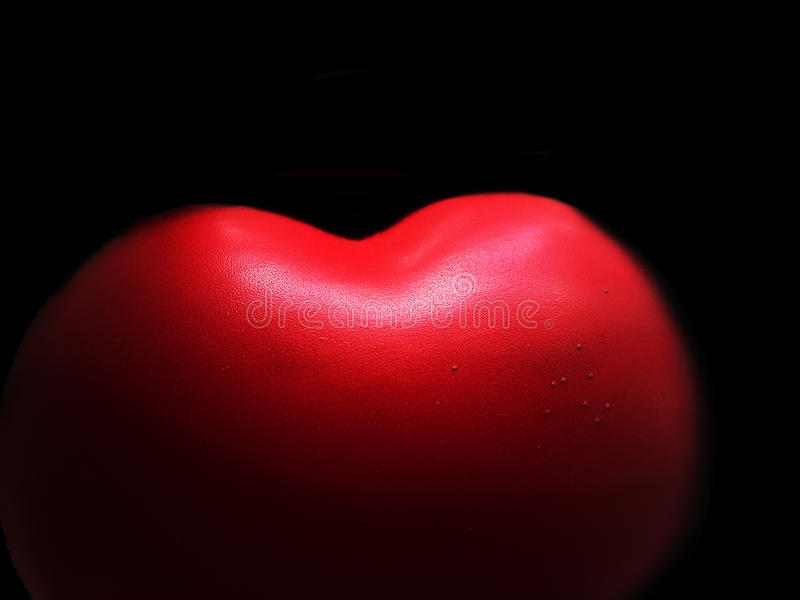 Download Red Heart On Black Background Stock Image