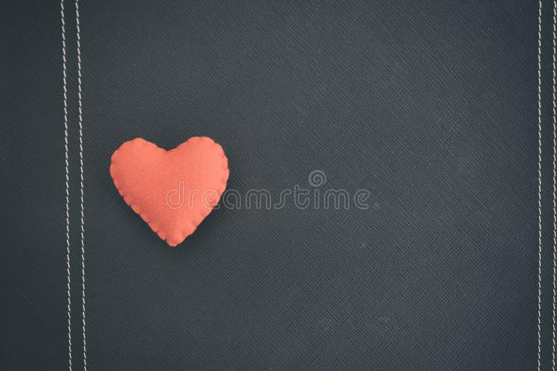 Red heart on black book. love backdrop. Background royalty free stock image