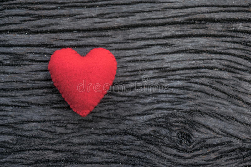 Red heart on black wooden background. Heart, red heart on black wooden background royalty free stock photography
