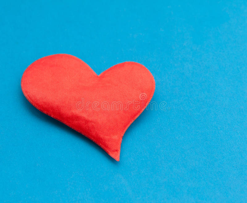 Red heart on blue background. royalty free stock photography