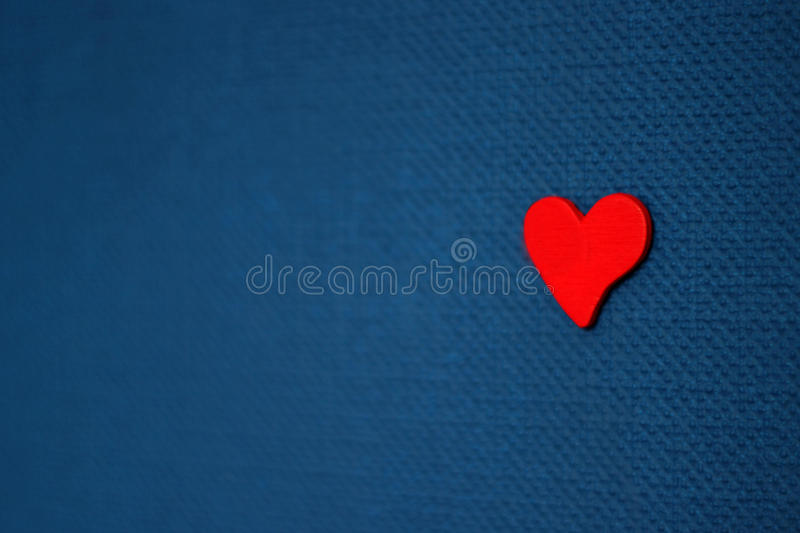 Red heart on blue background. Valentine`s day concept stock photo