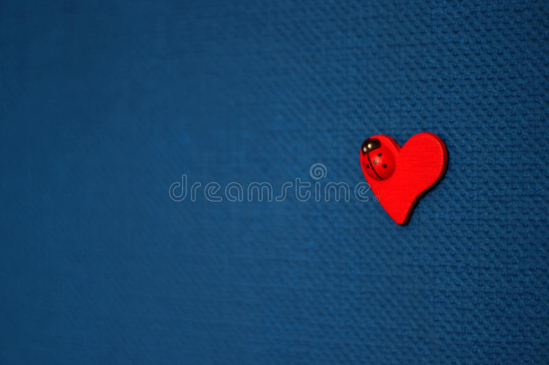 Red heart on blue background. Valentine`s day concept royalty free stock photo