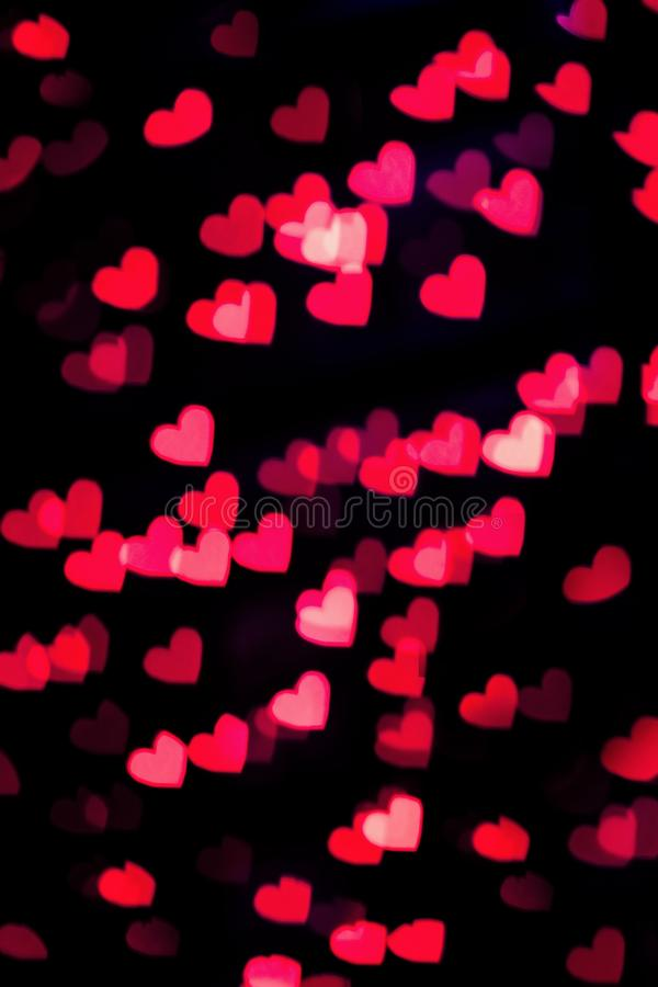 Red heart bokeh background. Red and pink heart bokeh background. Christmas and Valentine's day greeting cards, invitations, flyers, perfect for blog posts royalty free stock photography