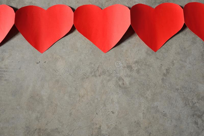 Red heart cement background stock photos