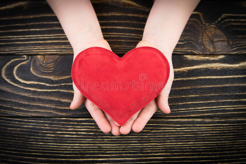 Red heart in children's hands royalty free stock image