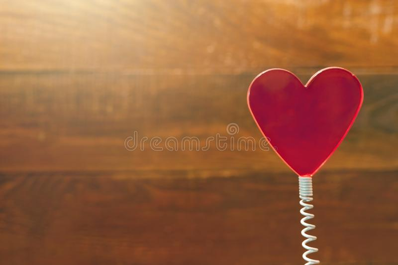 Red Heart On Coil Spring. Rustic Wooden Background. Saint Valentines Day, Love Card, Banner, Message Concept.  royalty free stock photo