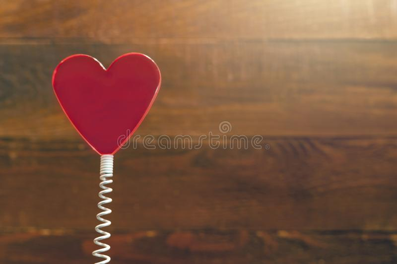 Red Heart On Coil Spring. Rustic Wooden Background. Saint Valentines Day, Love Card, Banner, Message Concept.  royalty free stock image