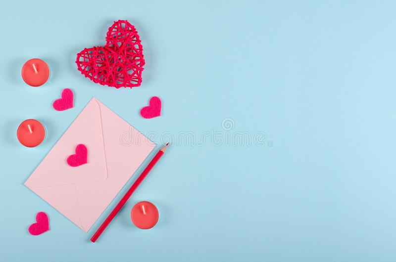 Red heart composition on blue background. Flat lay. Paper envelope with red heart composition on blue background. Flat lay, layout and tabletop mockup with copy royalty free stock photos