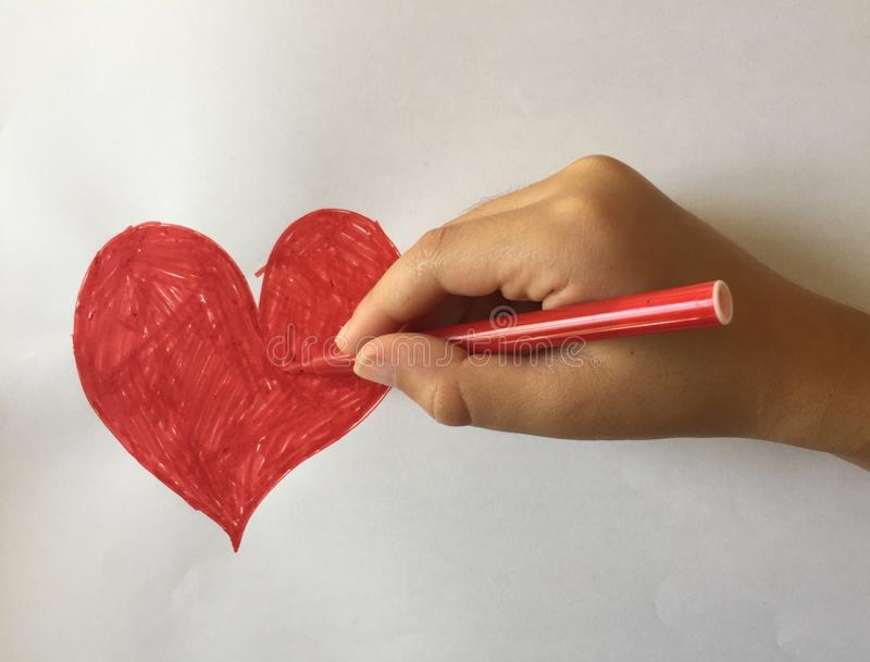 A red heart drawing. A child drawing a red heart royalty free stock photo