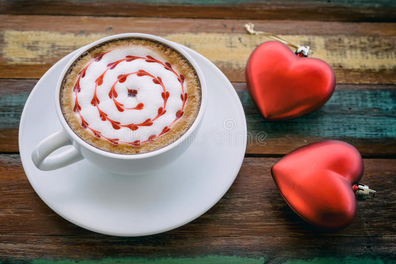 Red heart drawing on latte art coffee. With red heart royalty free stock photo