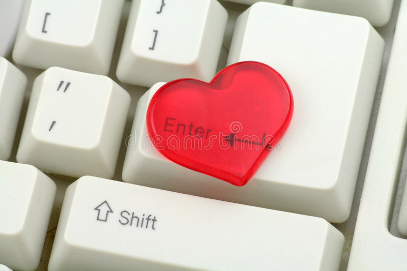 Red heart and enter key, love concept. Close up royalty free stock photos
