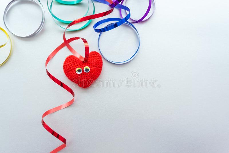 Red heart with eyes on the silver background. Merry emotions. St. Valentine Day, wedding, love royalty free stock images