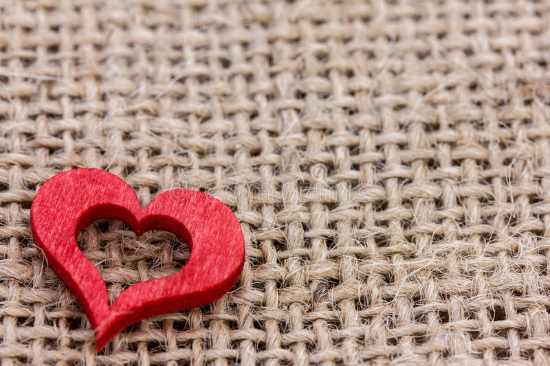 A red heart. Is on fabric royalty free stock photos