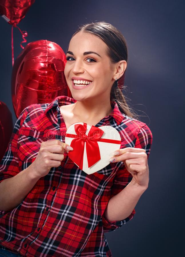 Red heart in female hands expressing love feelings royalty free stock photo