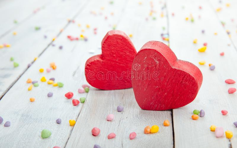 Red heart figures over vintage wooden background royalty free stock photo