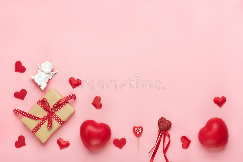 Red heart, gift box, white Cupid, candle on pink background Top view Flat lay Happy Valentine`s day, birthday, Women`s day concept royalty free stock photos