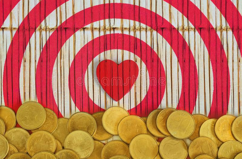 Red heart on gold coin money ,Valentine day. Concept stock image