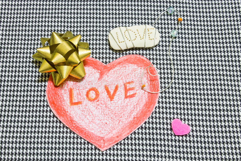 Red heart and gold ribbon stock photo