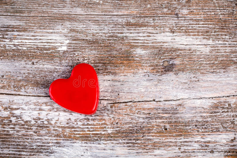 Red heart on grunge wood background royalty free stock image