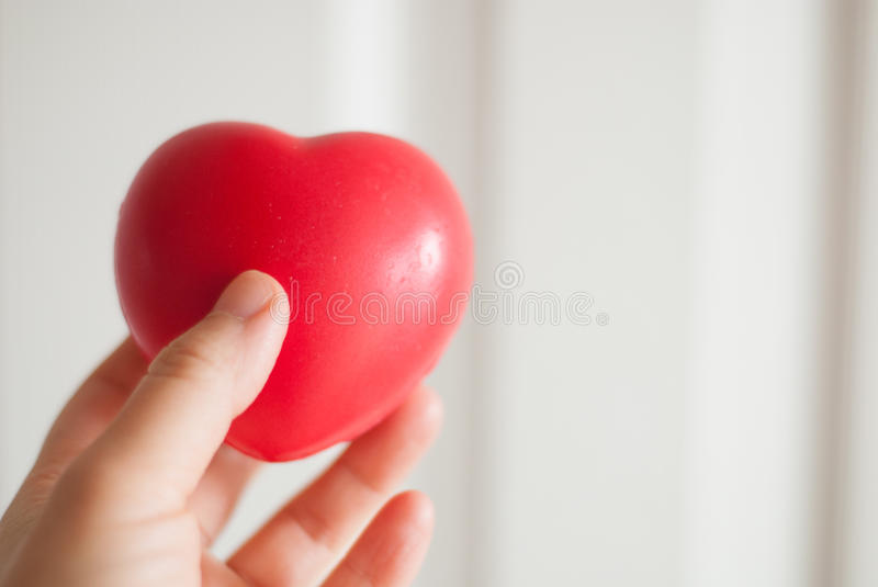 Red heart in hand. Red heart hold in human hand royalty free stock image