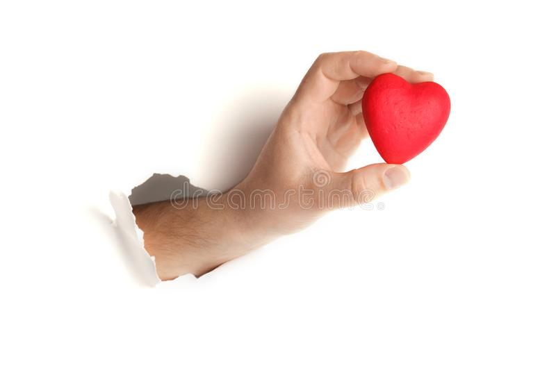 Red heart in hand on white background. Symbol of love and romance stock images