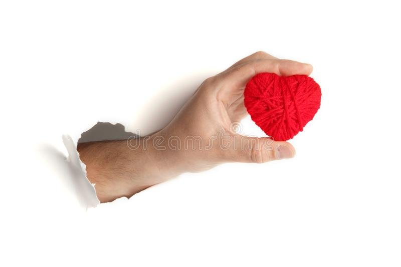 Red heart in hand on white background. Symbol of love and romance royalty free stock photos