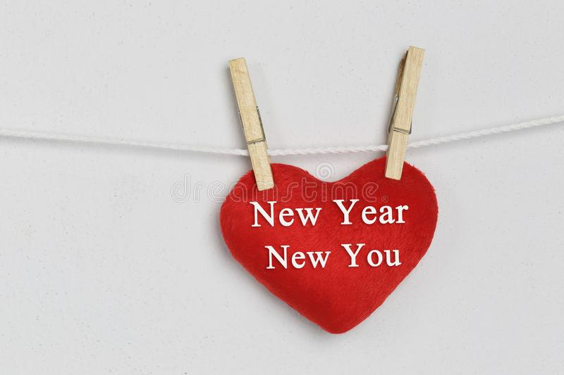 Red heart hanging on a rope and have New year New you text. royalty free stock photos
