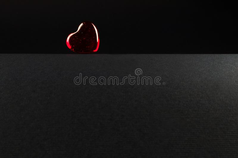Red heart with highlights on black parted background. With space royalty free stock photo