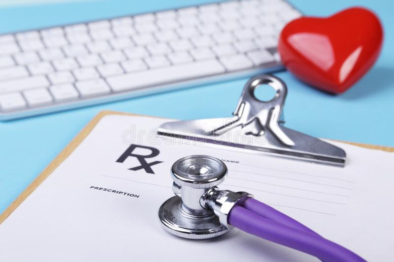 Red heart, keyboard and Medical stethoscope lying on cardiogram chart closeup. Medical help, prophylaxis, disease stock photos