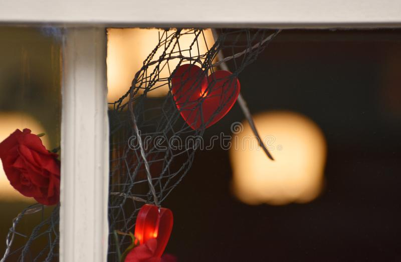 Valentines Hearts Light Decorations. Red heart light decorations in a shop window in the two weeks leading up to Valentine`s Day 2019 royalty free stock photo