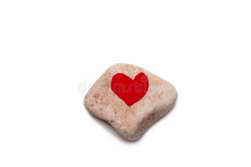 A heart shape on a pebble royalty free stock photography