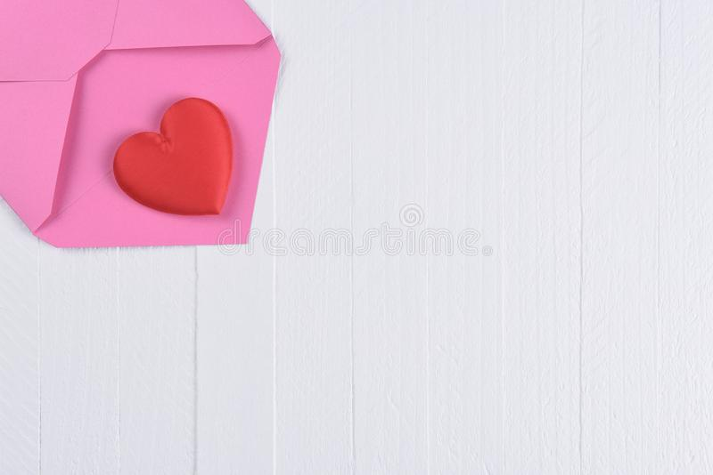 Red Heart on a Pink Envelope with Copy Space stock images